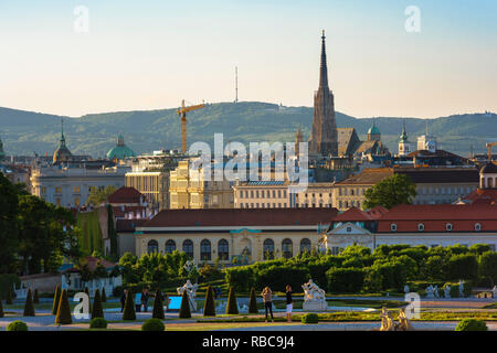 Vienna cityscape, view of the Vienna city centre skyline with the Schloss Belvedere palace in the foreground and Stephansdom cathedral spire beyond. - Stock Photo