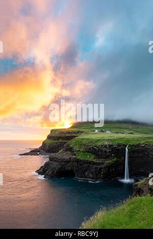 Gasadalur waterfall at sunset, Vagar, Faroe Islands - Stock Photo