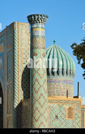 Sher-Dor Madrasah and minaret at the Registan square. A Unesco World Heritage Site, Samarkand. Uzbekistan - Stock Photo