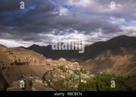 Rainbow over the Lamayuru Gompa monastery in Ladakh, Jammu and Kashmir, India - Stock Photo