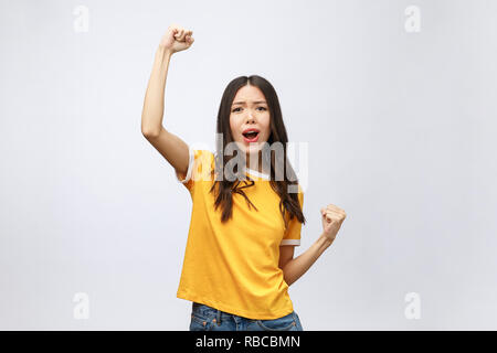 Beautiful asian young woman excited and glad of success , isolated over grey background, career freelance business concept. - Stock Photo