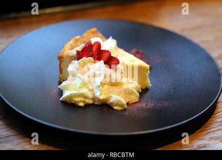 Cottage cheese casserole with whipped white chocolate and strawberries - Stock Photo
