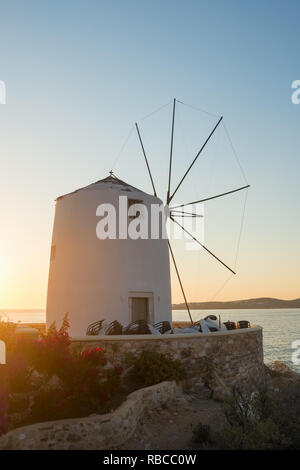 Traditional cycladic windmill at sunset on Paros island, Cyclades, Greece - Stock Photo