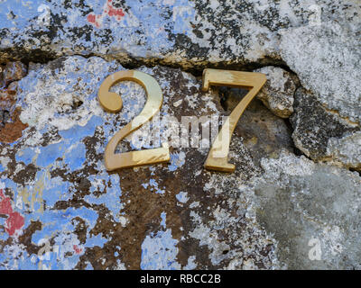 image of golden numbers on wall close up - Stock Photo
