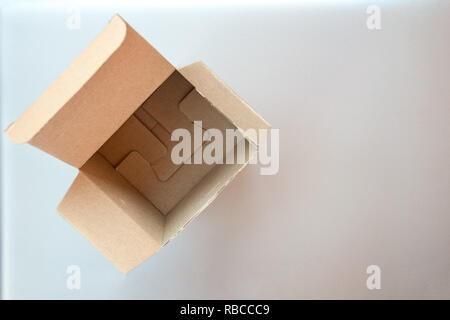 Opened big square cardboard craft gift box on the silver gray metal background - Stock Photo