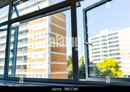 London, UK Window from flat with view of Churchill Gardens neighborhood in Pimlico, old historic traditional style buildings in summer, cheap housing - Stock Photo
