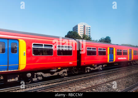 Horley, UK - June 28, 2018: Gatwick Airport South Western Railway metro with red and blue subway train in London airport, windows, sign - Stock Photo