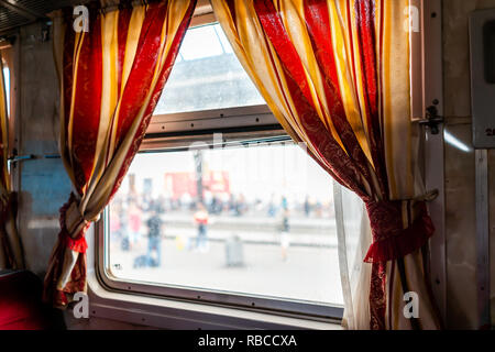 Lviv, Ukraine interior inside window architecture of Lvov or Lwow train station platform with crowd of people in background and Ukrainian design with  - Stock Photo