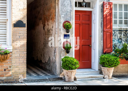 Charleston, USA downtown city street in South Carolina with nobody in southern town by old vintage houses architecture, narrow alley and door entrance - Stock Photo