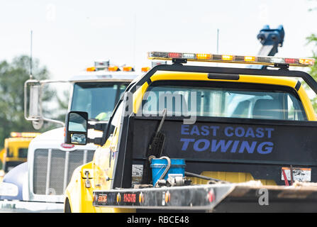 Raleigh, USA - May 13, 2018: Highway road in North Carolina with closeup of East Coast towing truck car by accident crash - Stock Photo