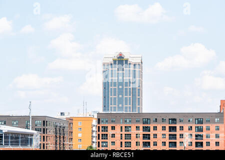 Raleigh, USA - May 13, 2018: Downtown North Carolina city skyscrapers during day with modern buildings and businesses, such as Wells Fargo Bank - Stock Photo
