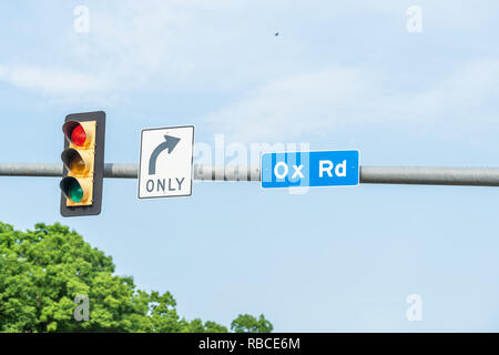 Closeup of Ox Road Rd or state route 123 sign in Fairfax County highway, Virginia isolated against sky with red traffic light and right turn only text - Stock Photo