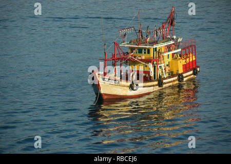Colorful fishing boat anchored in South China Sea, Kota Kinabalu, Sabah (Borneo), Malaysia - Stock Photo