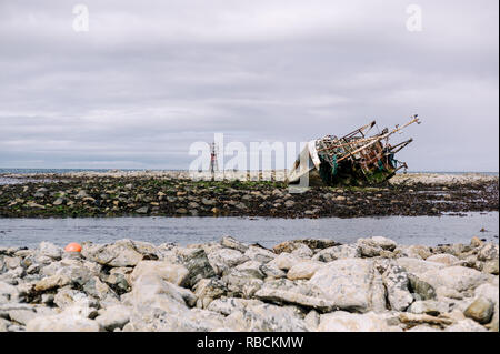 Wreck of Banff Fishing Vessel boat BF 380 aground on rocks at Fraserburgh, North East Scotland, UK - Stock Photo