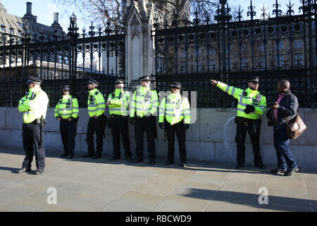 Extras police officers seen outside the House of Parliament in Westminster. Anti-Brexit demonstrators gather outside the British Parliament a week before the MPs to vote on the finalized Brexit deal, MPs will vote on Theresa May's Brexit deal on 15 January. - Stock Photo