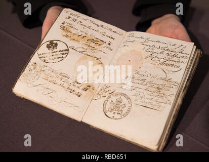 Bonhams Knightsbridge, London, UK. 9 January 2019. Voyages: a Journey in Books from Eton College Library is open to the public at Bonhams Knightsbridge saleroom till 18 January. Photo: The 80 exhibits include a 19th century Grand Tour Passport of Old Etonian Richard Durnford, issued February 1834 and recording visas and permits for the cities he passed through. Credit: Malcolm Park/Alamy Live News - Stock Photo