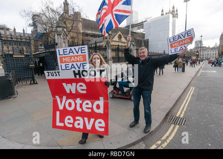 London, UK. 9th January 2019. Protesters stand in front of Parlamen with a signs calling for us to leave the EU aned encouraging motorists to hoot in support. Protests at Parliament continued by stop Brexit group SODEM (Stand of Defiance European Movement) and pro-Brexit campaigners. Credit: Peter Marshall/Alamy Live News - Stock Photo