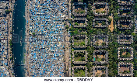 Mumbai. AMAZING aerial images have captured the stark contrast and inequality where rich meets poor all across the world. The spectacular bird's eye view pictures show the landscape as an affluent area gives way onto one where people may be suffering from poverty. The stunning shots show this crossover of the rich and poor all across South Africa, Kenya, Mexico and even the USA. The remarkable photographs form of africanDRONE founder and photographer Johnny Miller's (37) Unequal Scenes project. Johnny Miller / mediadrumimages.com - Stock Photo