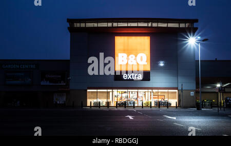 SWINDON, UK - NOVEMBER 18, 2018: Swindon showing B&Q Extra Super Store with Empty Car Park by night - Stock Photo