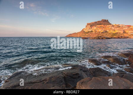The village perched on promontory framed by sea at sunset Castelsardo Gulf of Asinara Province of Sassari Sardinia Italy Europe - Stock Photo