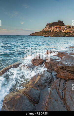 Waves of blue sea frame the village perched on promontory Castelsardo Gulf of Asinara Province of Sassari Sardinia Italy Europe - Stock Photo