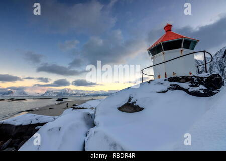 The blue arctic dusk on the lighthouse surrounded by snow and icy sand Eggum Vestvagoy Island Lofoten Islands Norway Europe - Stock Photo