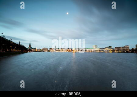 The colors and lights of twilight on Inner Alster Lake with the Christmas Tree suspended in its water Hamburg Germany Europe - Stock Photo