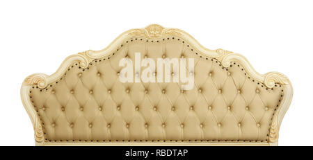 Shaped pastel beige color soft tufted leather capitone bed headboard of Chesterfield style sofa with carved wooden frame, isolated on white background - Stock Photo