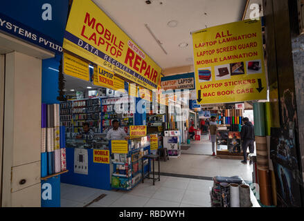 Computing and technology shops in the busy Nehru Place Shopping Centre in New Delhi. - Stock Photo