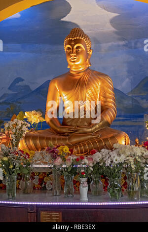 A statue of the Buddha in the Shrine Room at the New York Buddhist Vihara Association in Queens Village, Queens, New York City. - Stock Photo