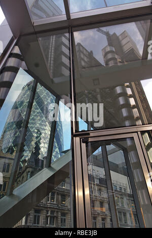 Reflection of Lloyd's building in the glass of The Scalpel, with the Gherkin showing through the other side. - Stock Photo