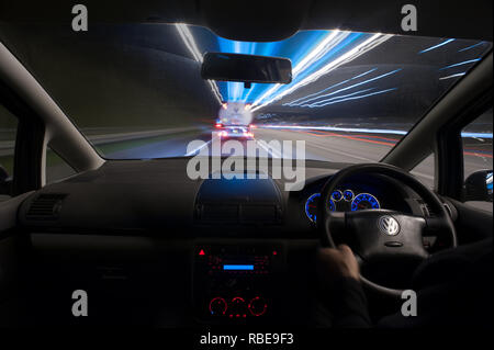 dashboard and steering wheel of car stuck in traffic using ...