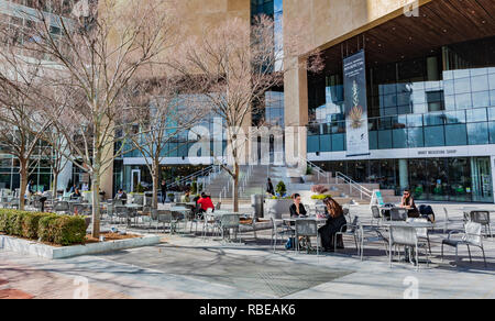 CHARLOTTE, NC, USA-1/8/19: The veranda in front of the Mint Museum in uptown attracts social life on a warm, sunny January day. - Stock Photo