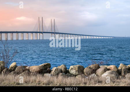 View of Oresund bridge during sunset over the Baltic sea - Stock Photo