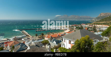Panoramic view of Simon's Town harbour from an elevated position looking out to sea with the mountains behine - Stock Photo