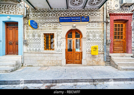 The post office decorated with the famous geometric scratch patterns in the medieval mastic village of Pyrgi on the island of Chios, Greece - Stock Photo