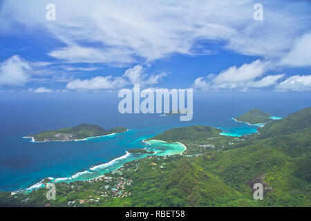Morne Blanc, with its shear cliff face, is the most iconic mountain on the island of Mahe. - Stock Photo