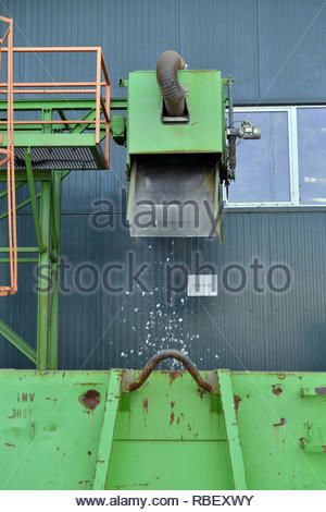 Recycled plastic waste is cut in small pieces and separated in containers, on a recycling plant - Stock Photo