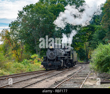 A relaxing sunny autumn afternoon steam train ride with engine #40 along the Connecticut River. Deep River, Connecticut, USA. Essex Steam Train. Rails - Stock Photo