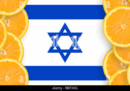 Israel flag  in vertical frame of orange citrus fruit slices. Concept of growing as well as import and export of citrus fruits - Stock Photo