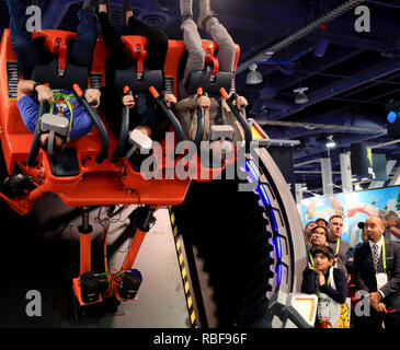 Las Vegas, USA. 9th Jan, 2019. Visitors experience a VR game during the Consumer Electronics Show (CES) in Las Vegas, the United States, Jan. 9, 2019. The annual CES kicked off Tuesday in Las Vegas. Credit: Li Ying/Xinhua/Alamy Live News - Stock Photo
