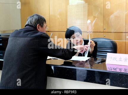 (190110) -- BEIJING, Jan. 10, 2019 (Xinhua) -- A staff member registers a case at Shanghai No. 2 Intermediate People's Court in Shanghai, east China, May 4, 2015. In November 2013, the 18th Central Committee of the Communist Party of China held its third plenary session to focus on comprehensively deepening reform. China has achieved all-round progress in deepening reform in its judicial and social systems in the five years after the session. (Xinhua/Ding Ting) - Stock Photo