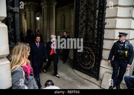 London, UK. 10th Jan, 2019. Prime Minister Theresa May and Japanese Prime Minister Shinzo Abe arrive at Downing Street ahead of bilateral talks. Credit: claire doherty/Alamy Live News - Stock Photo