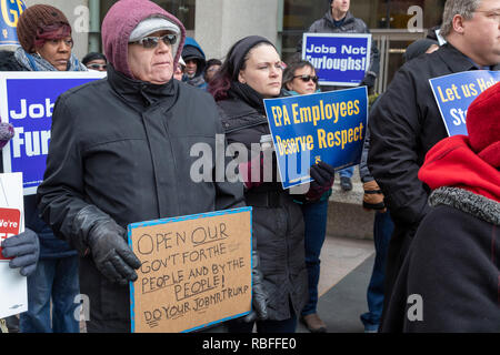 Detroit, Michigan USA - 10 January 2019 - Federal government employees rally at the federal McNamara Building to protest the partial government shutdown. The protest was led by the American Federation of Government Employees (AFGE). Many government agencies were closed after Congress would not agree to President Trump's demand for $5 billion to build a wall along the Mexican border. Credit: Jim West/Alamy Live News - Stock Photo