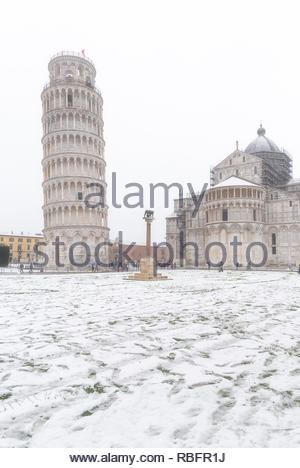 Leaning Tower and Cathedral in a snowy day, Piazza del Duomo, Pisa, Tuscany, Italy, Europe - Stock Photo