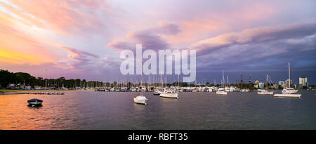 Swan River, Perth. Sunset over Mounts Bay Sailing Club at Matilda Bay, WA - Stock Photo