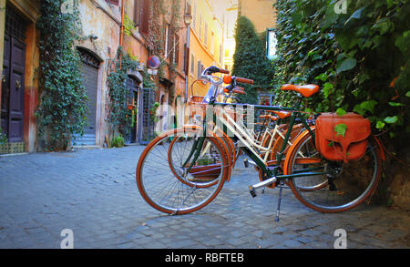 Bicycle standing in front of store on old street of Rome . - Stock Photo