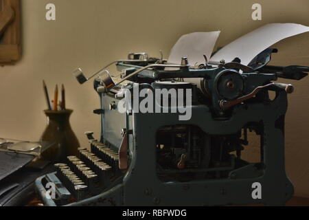 Old typewriter with papers - Stock Photo