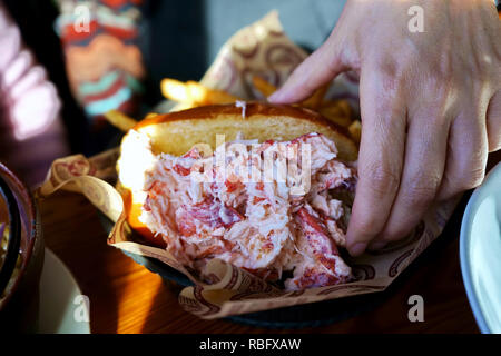 A Lobster Roll sandwich with french fries. - Stock Photo