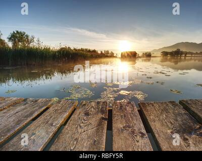 Beautiful mmorning at lake with traditional wooden boat house. Shore of famous mountain ake Nationalpark, Germany - Stock Photo